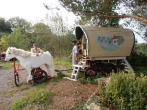 wooden horse and gypsy caravan